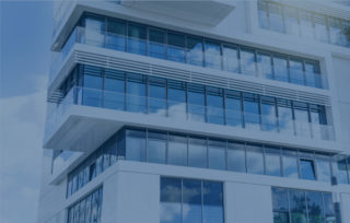 Glass facade modern building with blue filter