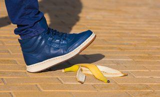 Stepping on a banana peel.